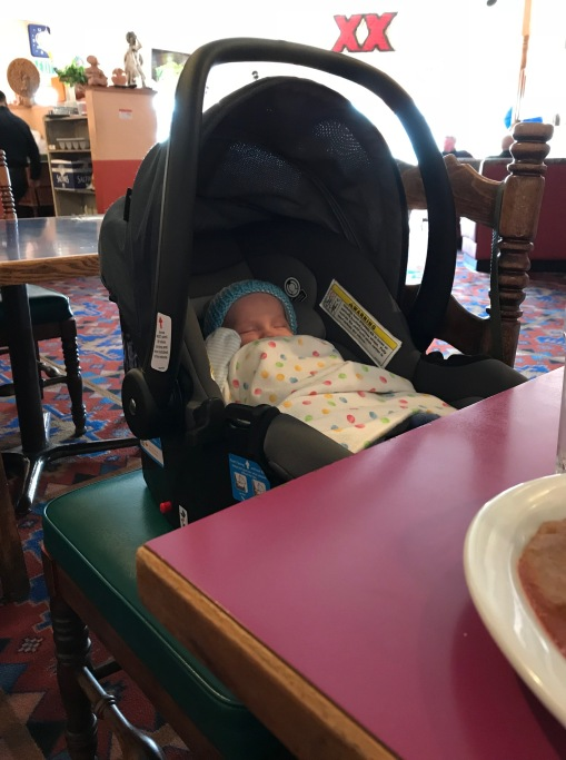 baby sleeping at Mexican restaurant
