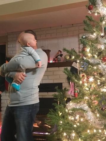 baby and Christmas lights